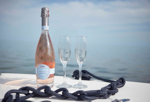 Champagne with two flutes on the dock