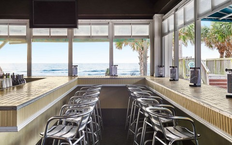 photo of restaurant seating with a view of the ocean