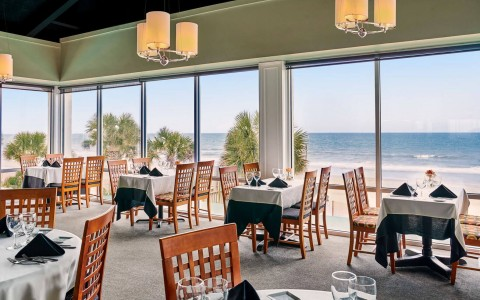 open dining area with beach view
