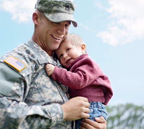 soldier holding child