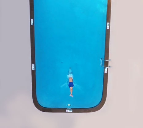 Aerial view of a man jumping in the pool