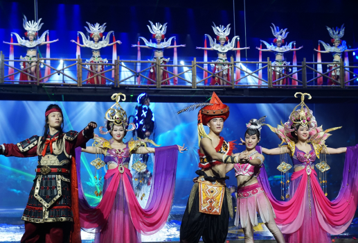Stage performers wearing elaborate Chinese costumes