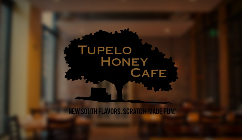 Tupelo Honey Cafe logo on a glass window