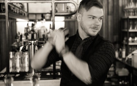 black and white photo of a bartender making a drink