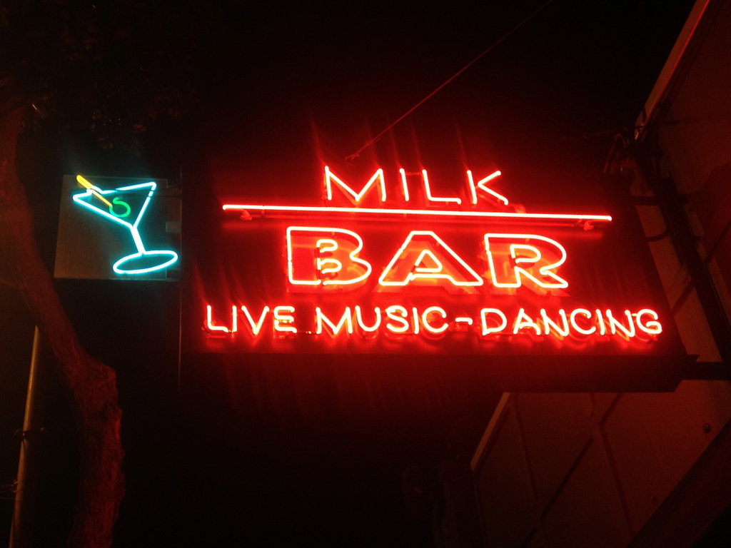 Milk Bar sign in bright red neon lights