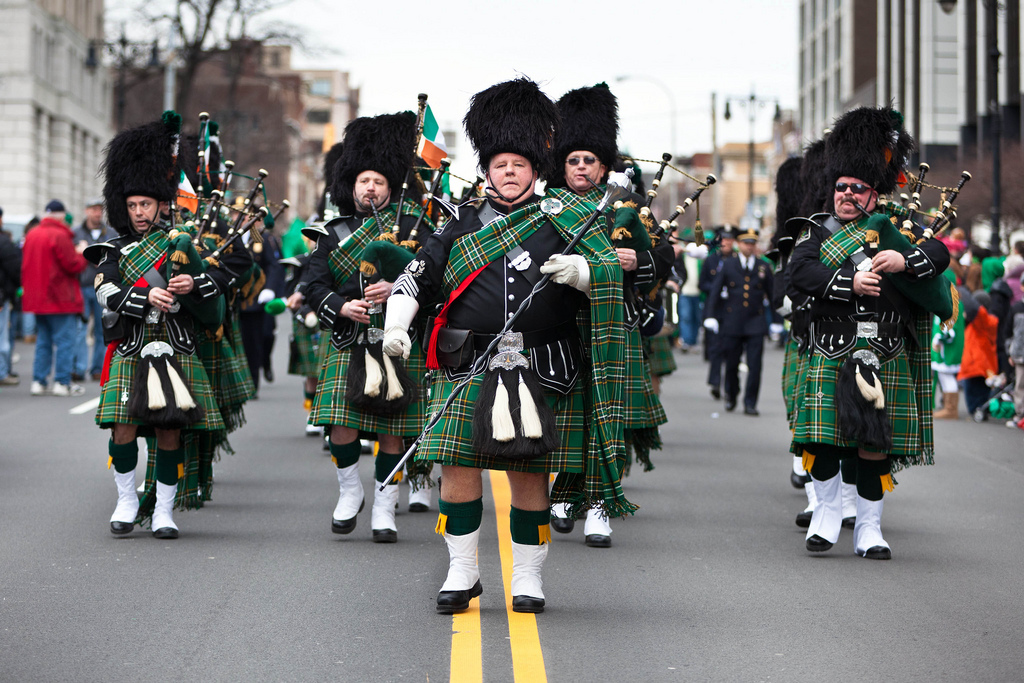 St. Patricks Day parade with bagpipes in the street