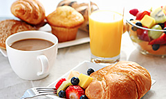 Breakfast items on white table cloth