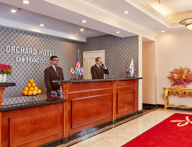 man at front desk of hotel with view of lobby