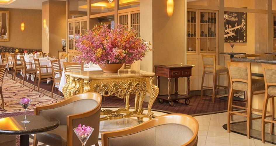 Orchard Daffodil restaurant with tables and chairs and pink floral arrangements
