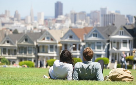Couple outside facing row houses