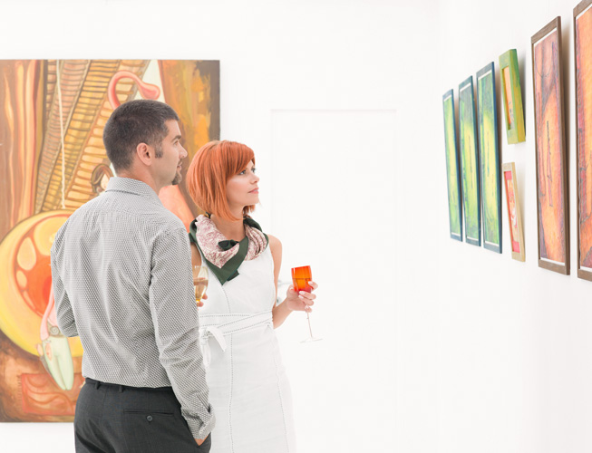 couple looking at painting at the Museum of Modern art