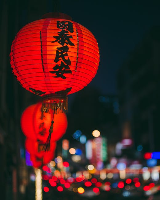 red chinese hanzi print lanterns floating over city lights