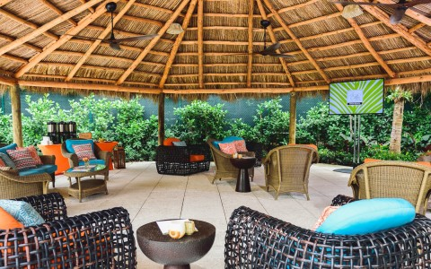 covered outdoor sitting area under the tiki