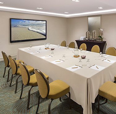 an indoor conference room with chairs set up
