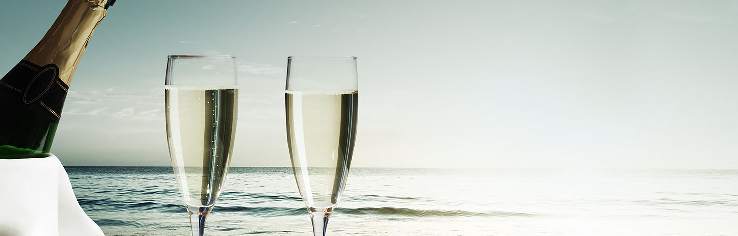 Champagne glasses on beach