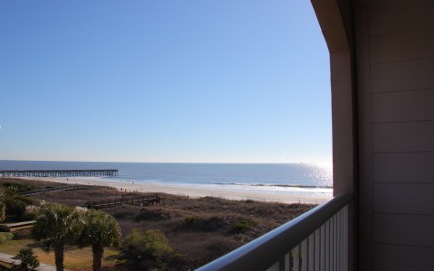 View of ocean water & pier from room balcony