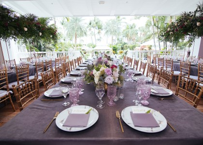 wedding set up with purple glasses and napkins