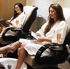 women getting pedicures