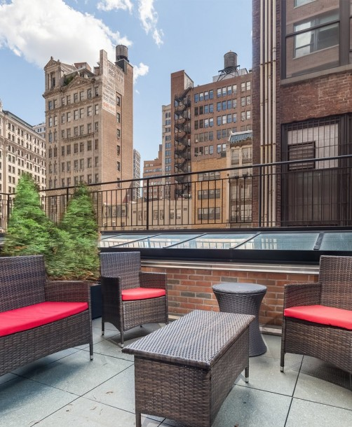 outdoor terrace with red cushioned patio furniture