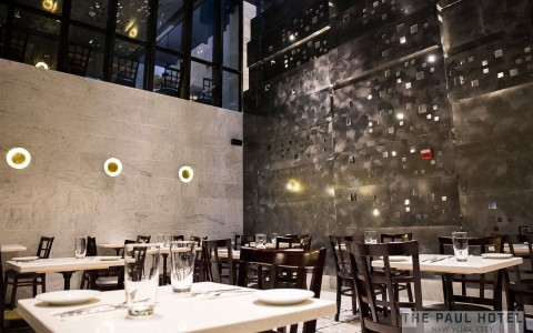 restaurant dining area with modern decor and table seating