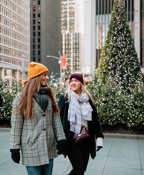 two women walking in new york city in winter