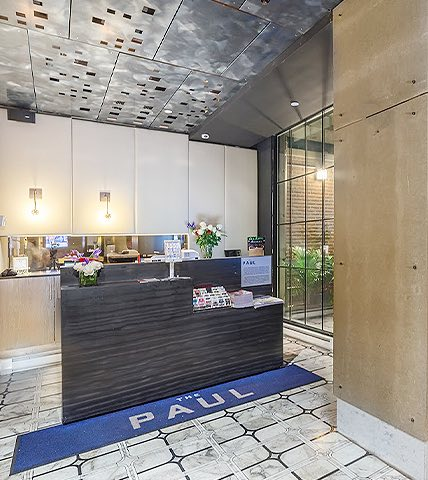 entrance and check in area at the paul hotel with modern floors and industrial accents