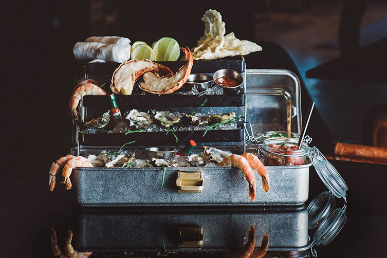 Lobster trails & jumbo shrimp on a three tier suitcase