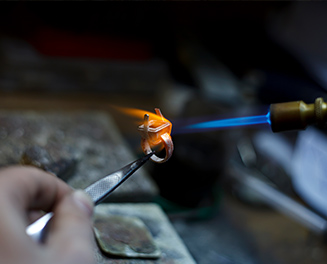 man lighting a ring on fire with a blue flame
