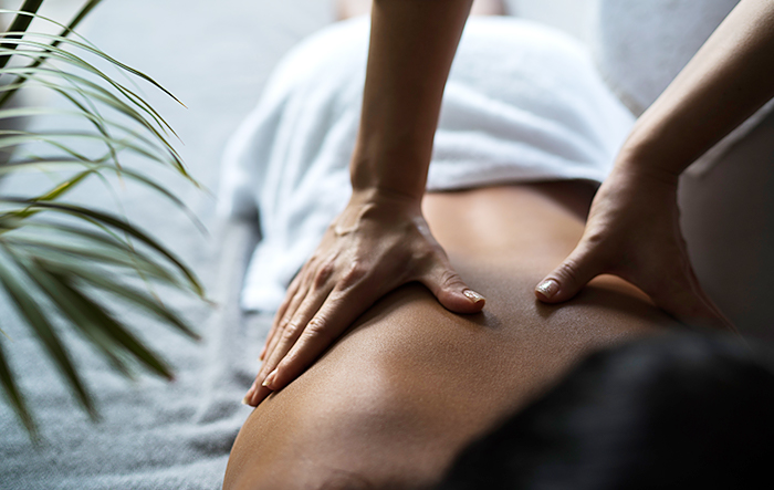 woman getting a massage with two hands