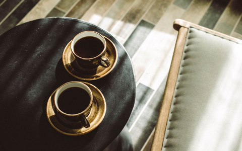 two cups of coffee in gold mugs