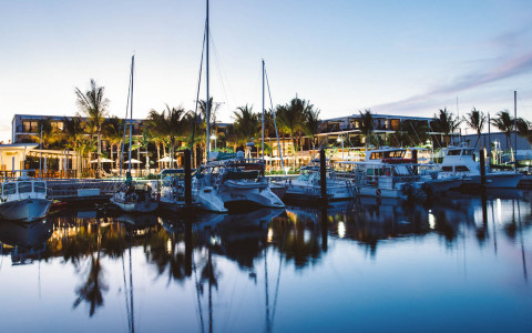 Evening view of boats docked at a marina