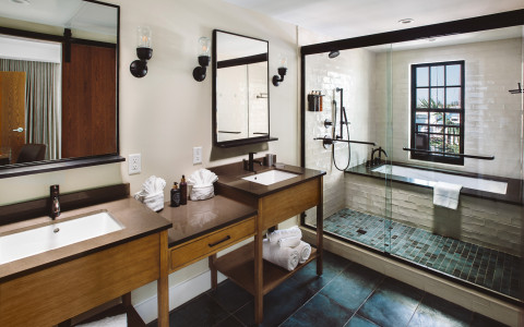 Hotel bathroom showing sinks and shower