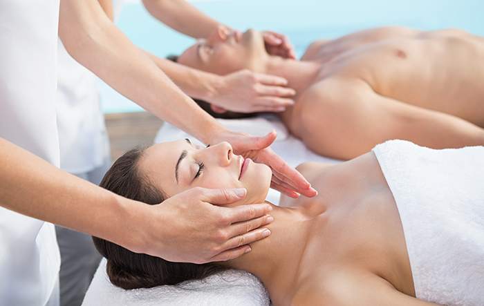 Woman laying in spa getting facial massage