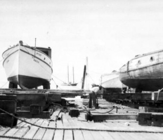 Black and white of boats docked on marina
