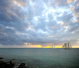 key west sunset with sailboats in the distance