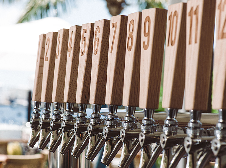 row of beers on tap