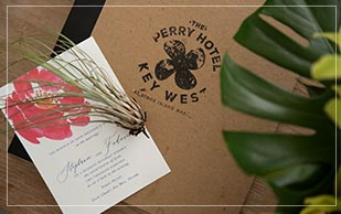 close up of wedding invitation at Perry Hotel