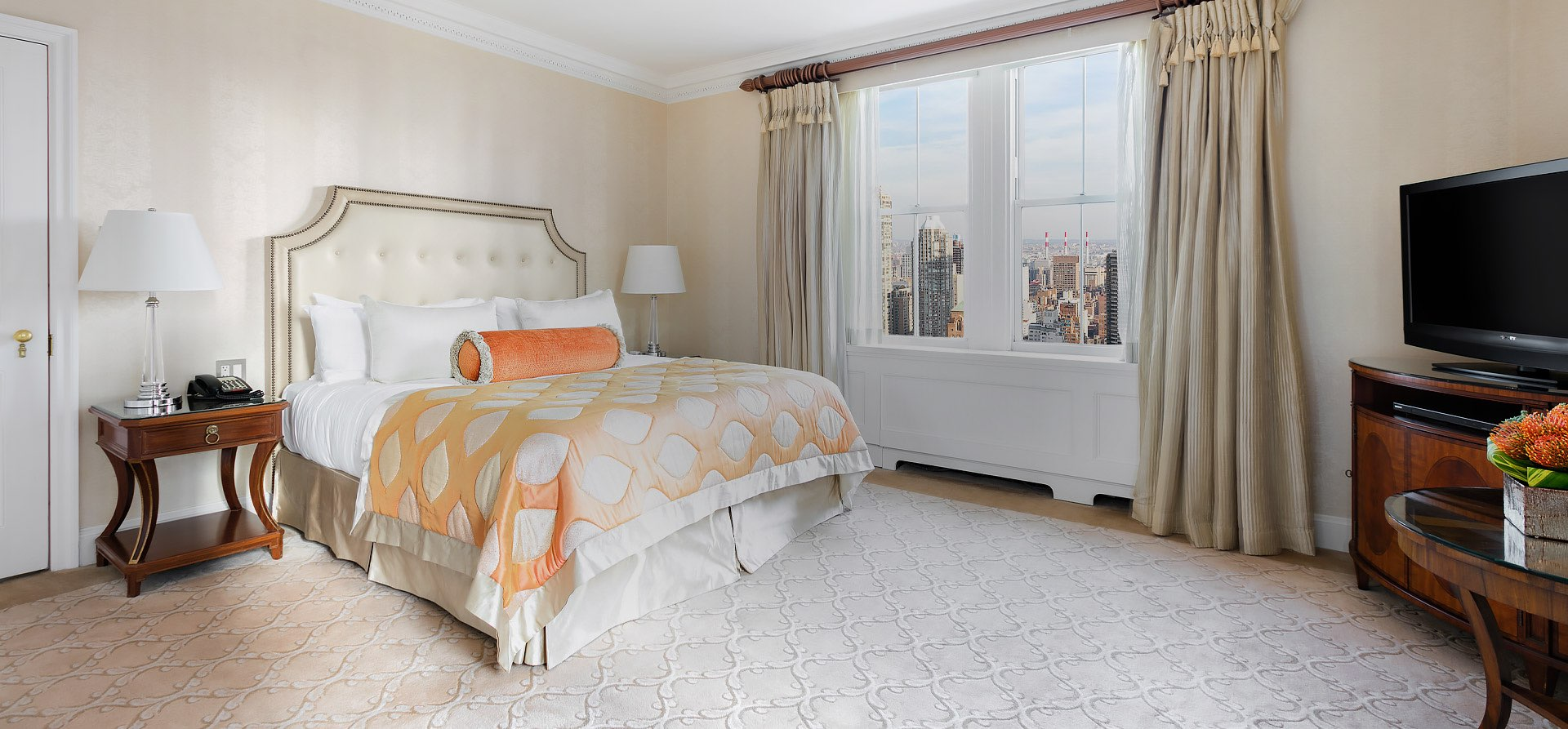 bright room with large bed and city view
