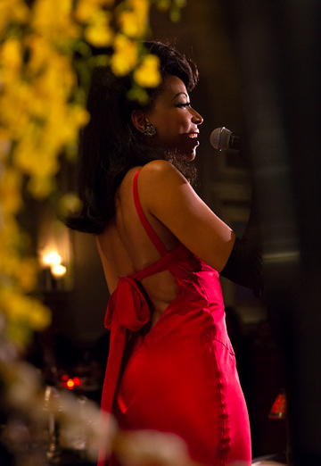 Woman in red dress singing