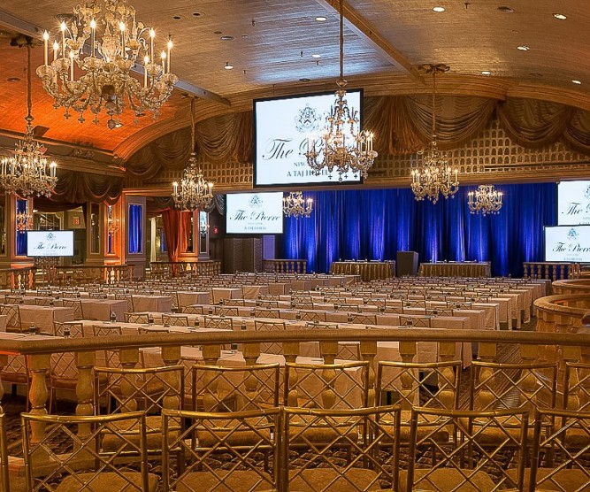 grand ballroom with big screens and chairs