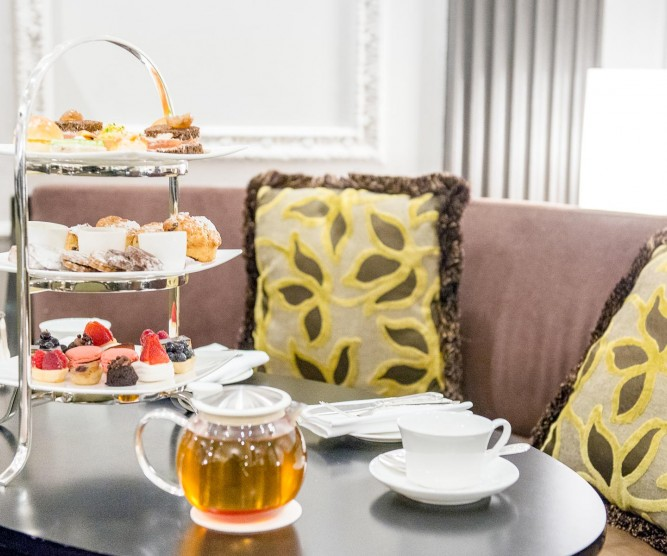 Pastries on three-tiered platter on table