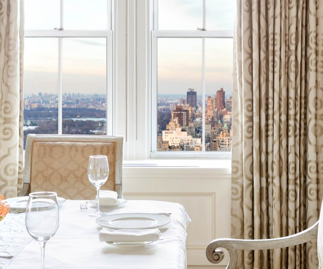 Dining table next to window with city view