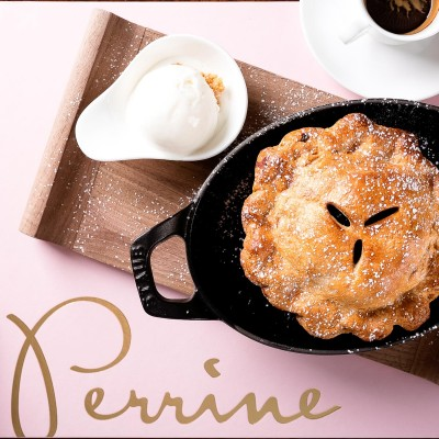 Pie from Perrine next to cup of coffee