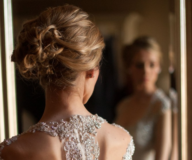 Bride with laced dress and updo hairstyle