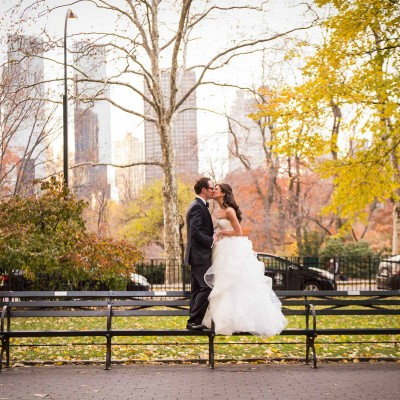 Bride and groom kissing in Central Park