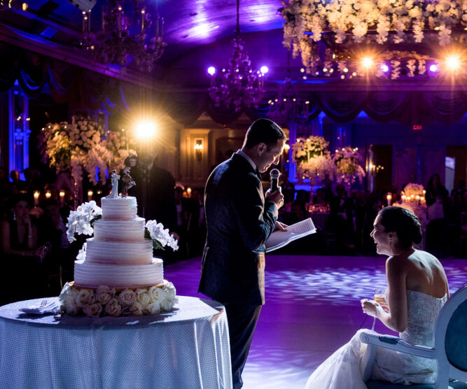 Groom reading to bride during reception