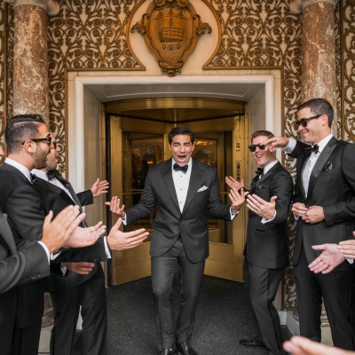 groom gives his groomsman many high fives