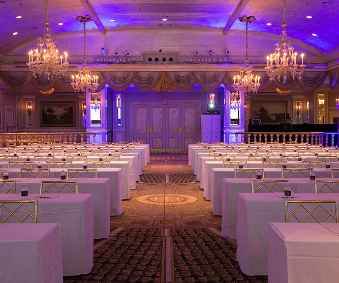 meeting space with purple lighting and chandeliers