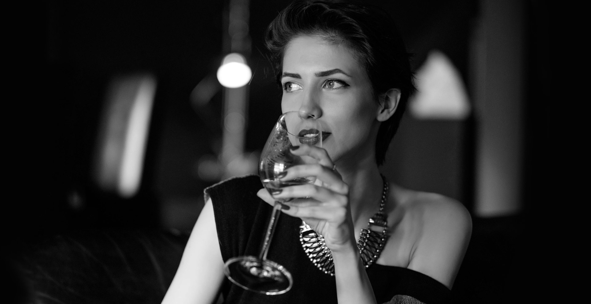 Woman sipping wine from glass