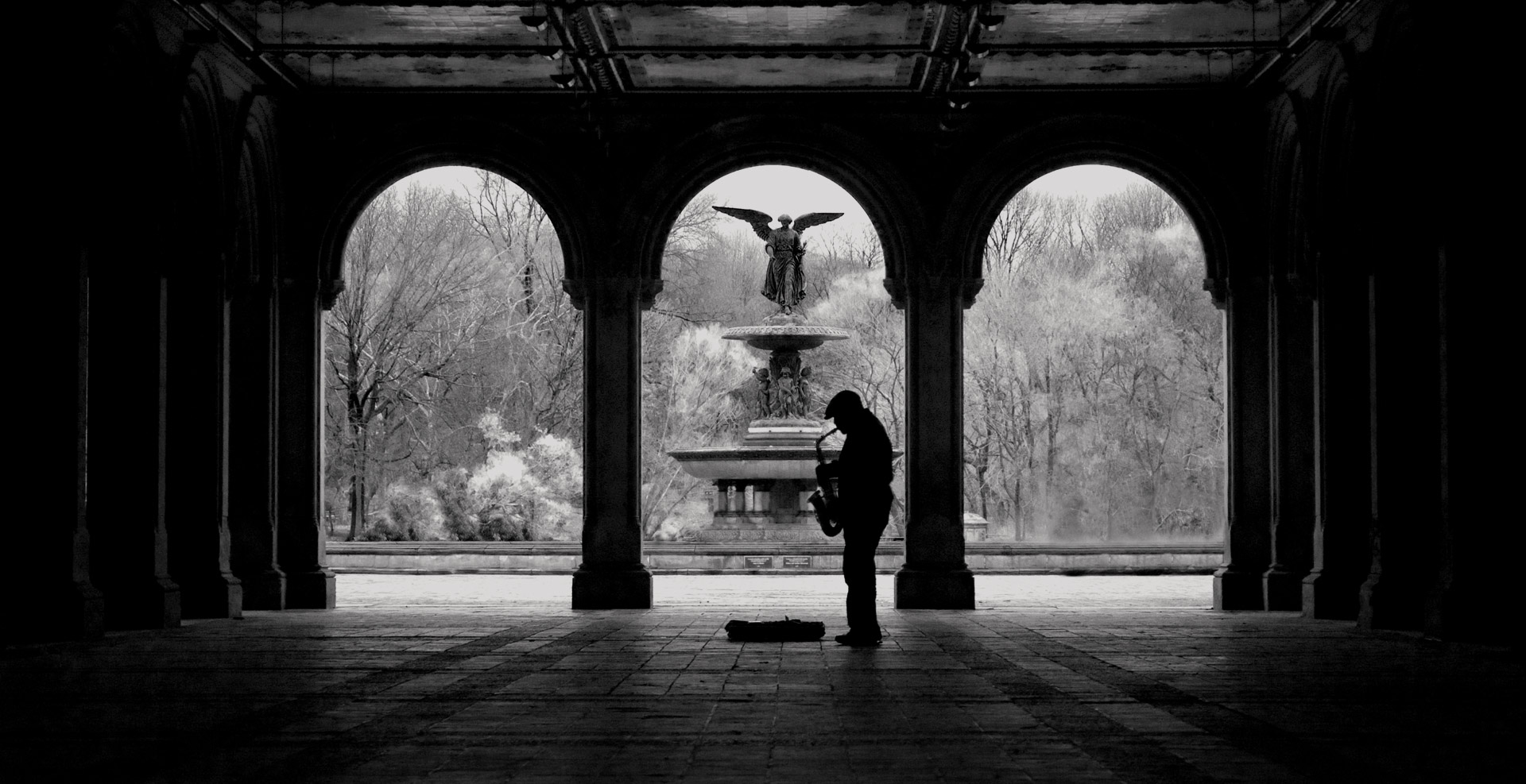 Man playing instrument in central park